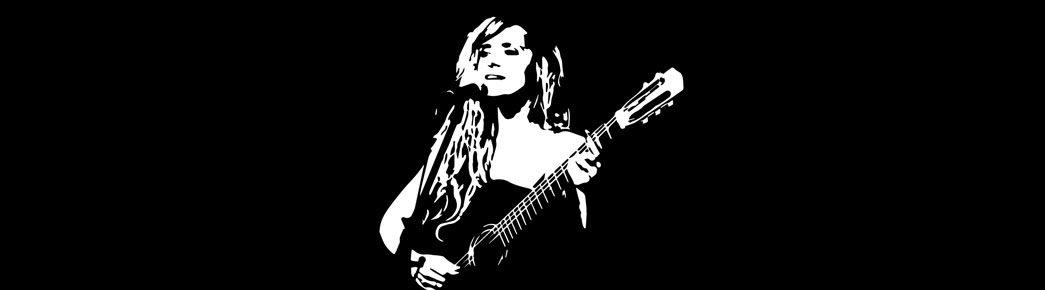 mujer tocando guitarra